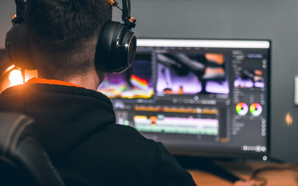 man using computer for video editing premiere pro color correction